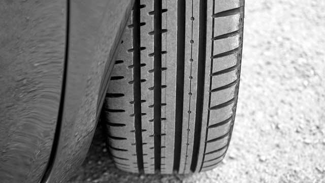 car with Ameristeel Tires on road